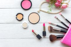 Makeup cosmetics tools background and beauty cosmetics, products and facial cosmetics package lipstick, eyeshadow with rose and pe stock photography