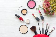 Makeup cosmetics tools background and beauty cosmetics, products and facial cosmetics package lipstick, eyeshadow with rose on the royalty free stock photo