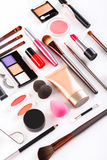 Makeup cosmetics tools and essentials, flat lay on white background Royalty Free Stock Photos