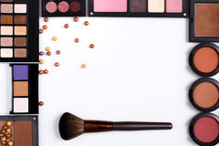 Makeup cosmetics tools and essentials frame background, copy space. Makeup cosmetics, brush and other essentials frame on white background. Top view, flat lay Royalty Free Stock Image