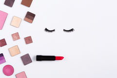 Makeup cosmetics tools and essentials frame background, copy space. Makeup cosmetics and essentials frame on white background. Top view, flat lay with copy space Royalty Free Stock Photography