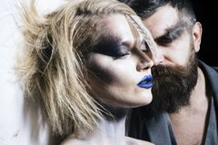 Makeup couple. Sensual woman and bearded man with makeup and stylish hair. We makeup your face. Makeup and beauty royalty free stock photography