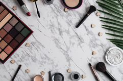 Makeup decorative cosmetic products on light marble background flat lay. Makeup decorative different cosmetic products on light marble background flat lay Royalty Free Stock Images