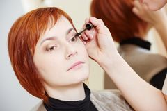 Makeup eye mascara application Stock Photo