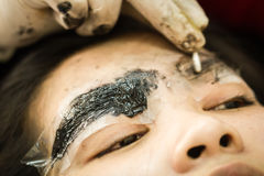 Makeup eyebrow tattooing, pretty asian woman face Stock Photography