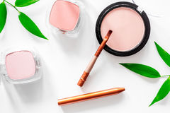 Makeup. Eyeshadow, brush and blush on white table background top view Royalty Free Stock Image