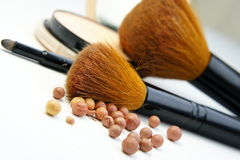 Makeup foundation, powder, bronzer and brushes Stock Photo