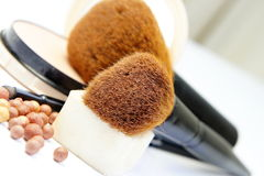 Makeup foundation, powder, bronzer and brushes Royalty Free Stock Image