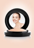 Makeup foundation powder case with beautiful model Royalty Free Stock Images