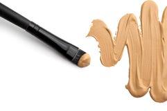 Makeup foundation. On white stock photo