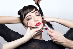 Makeup girl. Beautiful girl with makeup tools Stock Photos