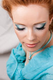 Makeup of the girl in blue Stock Photos