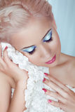 Makeup and Hairstyle. Blond girl with manicured nail and profess Royalty Free Stock Photography