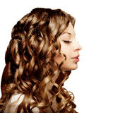 Makeup and hairstyle, curls. Young beautiful woman with luxuriou Stock Photo