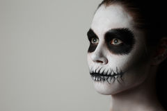 Makeup for halloween. gray background, isolated. Close-up. Halloween. Creative image. Facial mask Stock Image
