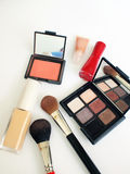 Makeup items. Including blush, lip gloss, nail polish, eye shadow palette, liquid foundation and brushes Stock Photo