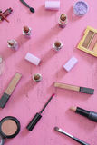 Makeup Items on Vintage Pink Wood Table Stock Images