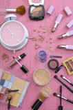 Makeup Items on Vintage Pink Wood Table stock image