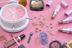 Makeup Items on Vintage Pink Wood Table Royalty Free Stock Images