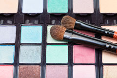 Makeup kit and cosmetic brushes Stock Photos