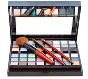Makeup kit and cosmetic brushes isolated Stock Photo