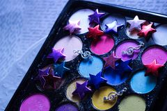 makeup kit eyeshadow colorful glitter music stars Royalty Free Stock Image