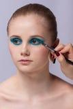Makeup. Kosmetyk. Stosować makijaż Fotografia Royalty Free