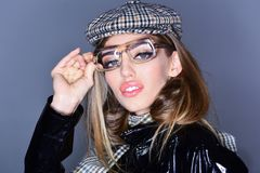 Makeup look for woman with soft skin. woman with stylish long hair in glasses. Autumn fashion for woman in hat and. Scarf. Beauty and hairdresser. Trendy girl royalty free stock image