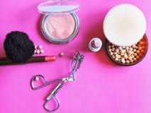 Makeup. A lot of makeup on pink background Stock Photos