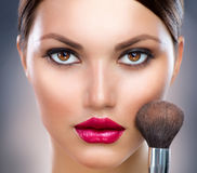 Makeup. Make-up Face. Beautiful Young Woman Applying Make-up stock photos