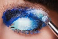Makeup. Make-up. Painting blue eyeshadows. Eye Royalty Free Stock Photos