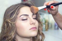 Makeup. Makes a girl in a beauty salon Stock Photo