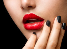 Makeup and Manicure. Black Nails and Red Lips Royalty Free Stock Photography
