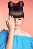Makeup. Manicure. Beautiful teen girl with bow hairstyle and mul Royalty Free Stock Photos