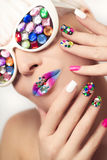 Makeup and manicure with crystals. Royalty Free Stock Photography