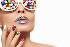 Makeup and manicure with crystals. Stock Image