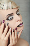 Makeup and manicure in gray. Stock Photos