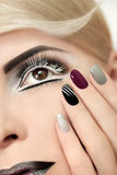Makeup and manicure in gray. Royalty Free Stock Image