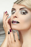 Makeup and manicure with grey. Stock Images
