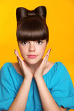 Makeup. Manicure. Hairstyle. Beautiful teen girl with bow hair s Stock Photos