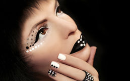 Makeup and manicure with rhinestones. Royalty Free Stock Photography