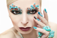 Makeup and manicure with turquoise. Royalty Free Stock Photos