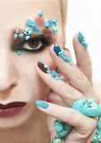 Makeup and manicure with turquoise. Stock Photos
