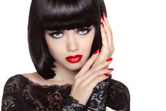 Makeup. Manicured nails. Beauty girl portrait. Red lips. Back sh Stock Photography
