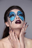 Makeup. Manicured nails. Fashion face art portrait. Beautiful mo Stock Photography