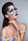 Makeup. Manicured nails. Fashion face art portrait. Stock Photography