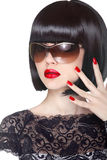 Makeup and manicured polish nails. Fashion brunette woman. Wearing in sunglasses  on white background. Professional model Stock Images