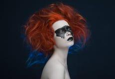 Makeup mask red hair girl. Studio royalty free stock images