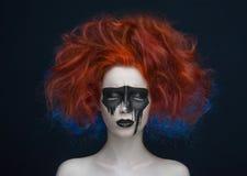 Makeup mask red hair girl. Studio stock photography