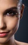 Makeup med rhinestones royaltyfri foto
